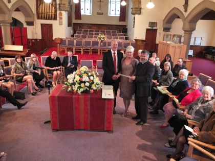 Rev Ian Lucraft presents Shirley and David with their certificate.