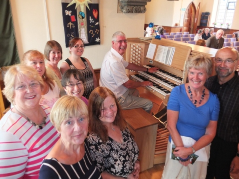 mark and choir at organ